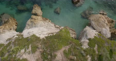 toszkána : Aerial view of Capobianco, a white cliff coast with crystal clear water in the Mediterranean Sea, Elba Island (Italy) Stock mozgókép