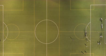 eye ball : Top view with trail effect of soccer players running around the field.