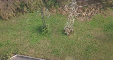 izolace : Aerial view of a power line transmission tower on an autumn morning.