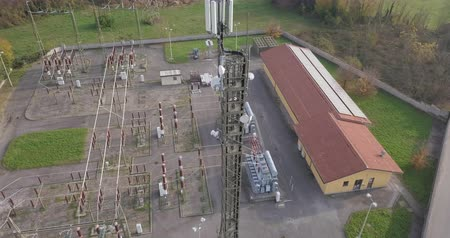 voltů : Aerial view of a high voltage power substation on an autumn morning.