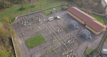 средства : Aerial view of a high voltage power substation on an autumn morning.