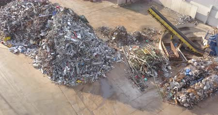 megragad : Aerial view of metal waste. Recycling industry. Separation of ferrous metals.