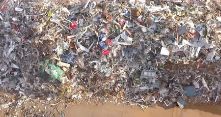 Aerial view of a pile of metallic waste on a recycling area. Стоковые видеозаписи