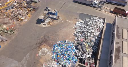 Aerial view of metal waste. Recycling industry. Separation of ferrous metals.