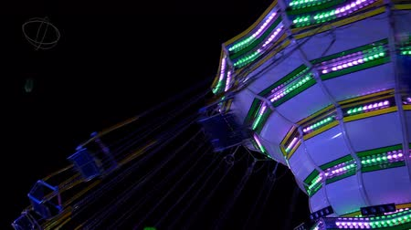 luna : A swinging fair ride in an amusement park at night, Como (Italy)