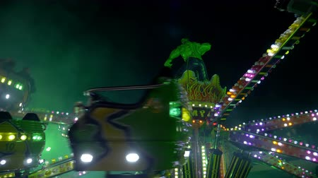 frisson : A jumping ride carousel in an amusement park at night, Como (Italy)