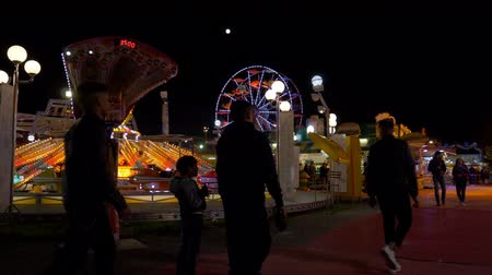 luna : Fairground attractions at amusement park at night, on April 26, 2019 in Como (Italy)