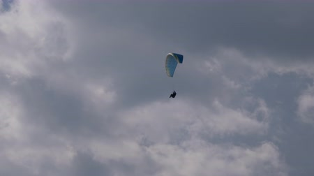 asma : Paraglider flying against a cloudy sky