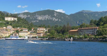Arriving by ferry to the city of Bellagio, with its grand hotels in the heart of Lake Como, Italy Стоковые видеозаписи
