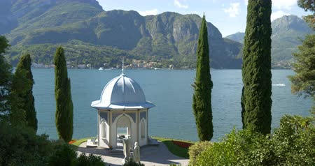 A chapel with cypresses on the garden of the Villa Melzi d'Eril on Lake Como, Italy
