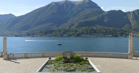 View of Lake Como seen from the romantic garden terrace o Стоковые видеозаписи