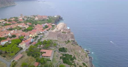 promontory : Aerial view of the Fort of San Giorgio, a 16th century castle located on a hill near the port of the Island of Capraia, Tuscan Archipelago, Italy.