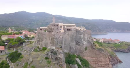 Aerial view of the Fort of San Giorgio, a 16th century castle located on a hill near the port of the Island of Capraia, Tuscan Archipelago, Italy.