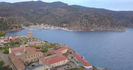 promontory : Aerial view of the small marina of Capraia Island, Tuscan Archipelago, Italy. Stock Footage