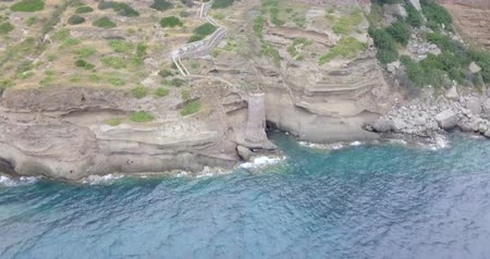 promontory : Aerial view of the 16th century fortifications located on the rocky promontory on the island of Capraia, Tuscan Archipelago, Italy. Stock Footage