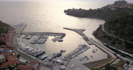 Aerial view of the small marina of Capraia Island, Tuscan Archipelago, Italy. Стоковые видеозаписи