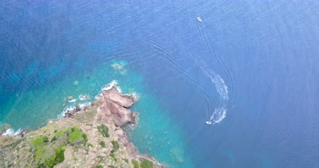 promontory : Aerial view of a motorboats in the blue sea of the Capraia Island in the Mediterranean Sea