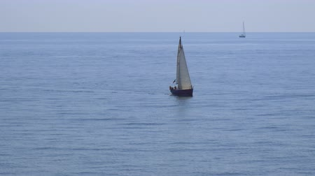 A sail boat in a quiet Mediterranean Sea