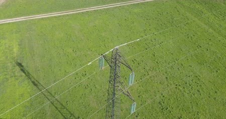 transzformátor : High voltage tower from above, green meadow background
