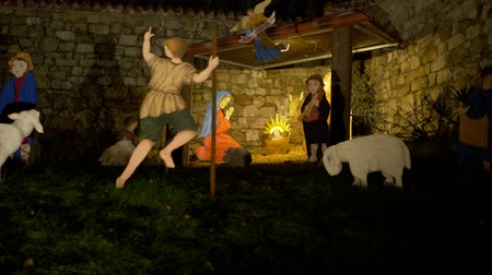 jesus born : Nativity scene with hand-colored figures made out of wood including Jesus, Mary, Joseph and sheep Stock Footage