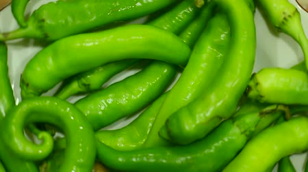 peper : Green organic peppers rotating. Loopable top view. Stock Footage