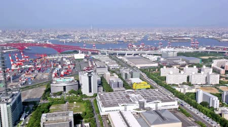pier : Aerial panoramic view of industrial Osaka bay and city skyline of Osaka, Japan