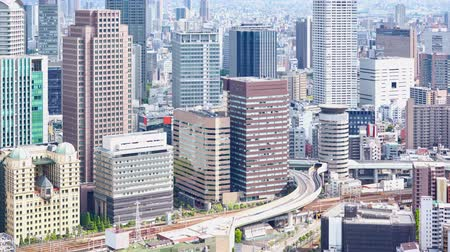 osaka : timelapse of aerial view of Umeda District of Kita, view from Umeda Sky Building, Osaka, Japan, UHD