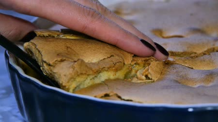 charlotte pie : A woman takes a piece of cake. Making apple pie. Organic food. Stock Footage