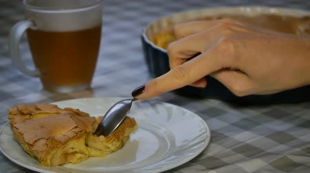 charlotte pie : Slice of homemade apple pie and hot tea on the table. Apple pie and cup of hot tea.