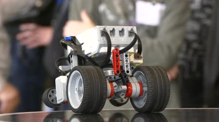 construtor : Childs hand launches robot program.close-up.