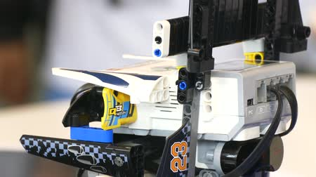 Childs hand launches robot program.close-up.