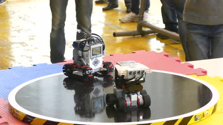 sumo sparring of two robots. Automated robots of machines battle with each other in the ring Stock Footage