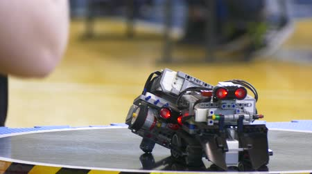technics : sumo sparring of two robots. Automated robots of machines battle with each other in the ring Stock Footage