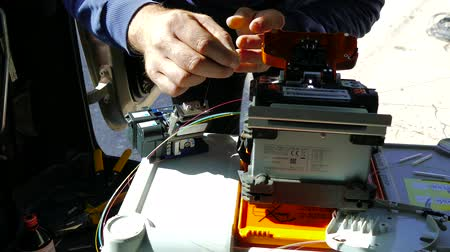 Working on fiber optic cable splice machine, technology for high internet speed