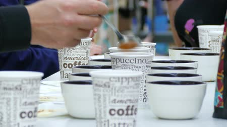 People with coffee spoons tasting coffee. Stock Footage