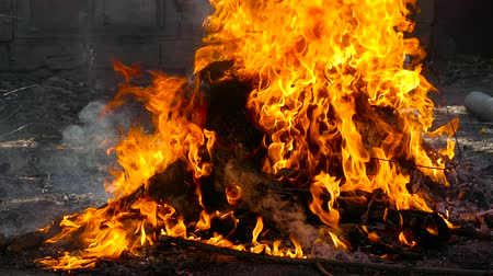 The fire burns with building debris, the fire burns plastic and expels metal. Stock Footage