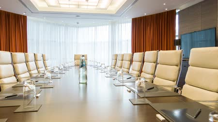 irodaház : Meeting room. Long table with leather armchairs in empty room for business meetings in premium business center