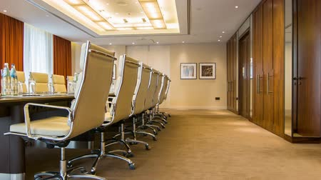 interior : Conference room. Modern boardroom in beige colors with mirror wall and comfortable armchairs Vídeos