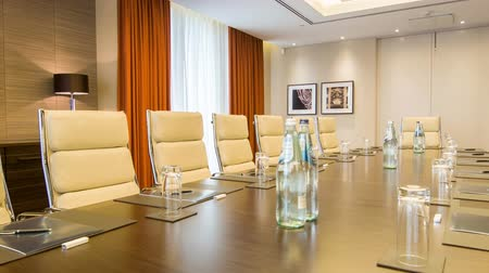 tablo : Meeting room. Long table with leather armchairs in empty room for business meetings in premium business center