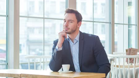 modern manhood : Pleasant businessman sitting in the cafe Stock Footage