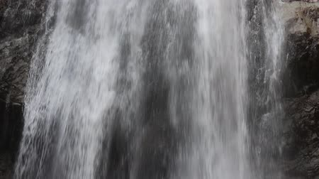 vdo : waterfall pouring down, slow motion shot