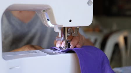video reel : old woman working with a sewing machine Stock Footage