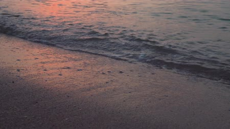 settings : Waves at sandy beach on beautiful sunset