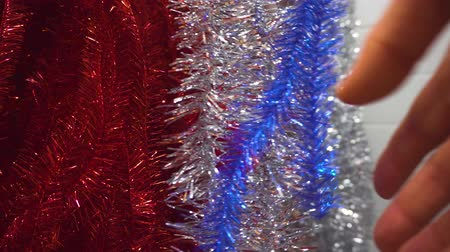 Christmas shopping. Male hand choosing decoration for Christmas and New Year, tinsel Dostupné videozáznamy