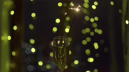 Sparkler burn at the background of the garland and window