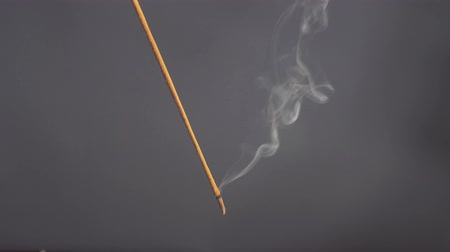 Incense stick are burning and smoke on gray background,Smoke from incense