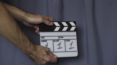 cinematography : Hands using movie production clapper board