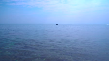 mírumilovnost : Seascape, sea view in sunny day, dark blue sea, blue sky, small clouds, calm sea surface, ripple soft waves.