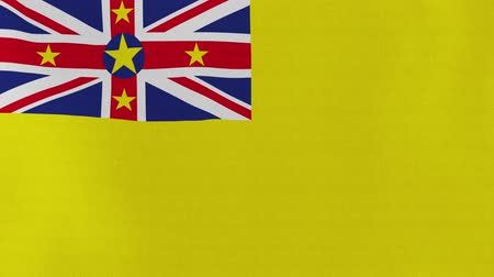 nu : [loopable] Flag of Niue.  Niuean official flag gently waving in the wind. Highly detailed fabric texture for 4K resolution. 15 seconds loop.  Source: CGI rendering.