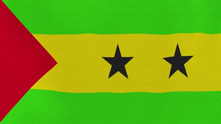tome : [loopable] Flag of Sao Tome and Principe.  São Toméan official flag gently waving in the wind. Highly detailed fabric texture for 4K resolution. 15 seconds loop.  Source: CGI rendering.